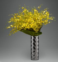 Art Deco Sunshine -  A lush arrangement of yellow oncidium orchids sculpted with philodendron leaves | L'Olivier Floral Atelier