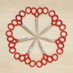 Composition 12. 7 pairs of training scissors.