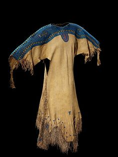 Woman's Dress Date: ca. 1855 Geography: United States Culture: Central Plains, probably Lakota Medium: Native-tanned leather, glass beads, brass bells