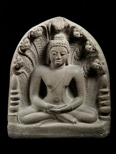 Buddha in Meditation under a Seven-Headed Naga, 7th century. Central Thailand. Lent by National Museum, Bangkok (DV9) | This seated Buddha, deep in meditation, is protected by a seven-headed naga (snake). The Buddha is flanked by two cylindrical stupas (stupa kumbha) with multiple umbrellas, emblematic of Buddha relics. #LostKingdoms