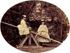 Alice Liddell, on whom Alice in Wonderland was based, on a see-saw with her sister Lorina. Photograph by Charles Lutwidge Dogson (aka Lewis Carroll). England, 1850s.