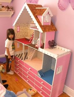 """This is the most unique and """"why didn't I think of it"""" doll house! The drawers organize all the toys and doll clothes and """"extras"""" that kids seem to find and add to their collection. Just need a small dresser. Small Dresser, Diy Casa, Barbie Doll House, Barbie Dolls, Diy Dollhouse, Dollhouse Design, Victorian Dollhouse, Dollhouse Miniatures, Doll Furniture"""