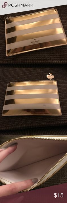 Kate Spade Pencil Bag Gold and white striped pencil case. Small scuff on back (as pictured). 100% authentic. kate spade Bags