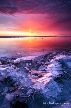 Ice build up and morning sunrise on Lake Superior. Duluth, MN. Photo by Nate Lindstrom.