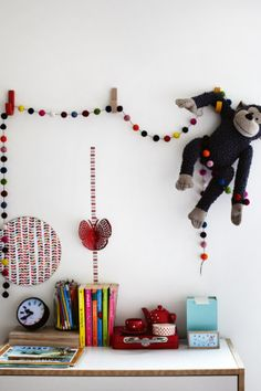 6. Create a fun and lively area by stringing up colourful felt balls and special stuffed toys. Try displaying tea set...