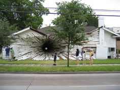 """🔮  """"The Hole House, Houston, Texas, USA. This house with a trans-dimensional vortex (or a black hole?) was a limited time art project in the spring of 2005, designed & constructed by sculptors Dan Havel & Dean Ruck.   (viaDornob)""""          NOTE: PRESS """"READ IT"""" TO SEE A CLOSE-UP OF THE HOLE & ANOTHER PHOTO OF THIS HOUSE + PHOTOS OF OTHER """"SMASHED"""" BUILDINGS.      NTS: """"V/RI"""" section ✔️"""