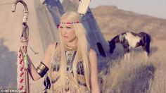 Transformation: No Doubt singer Gwen Stefani sports a native American style dress and a feather headdress for No Doubt's new music video Looking Hot