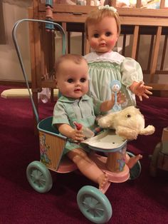 Vintage ideal kissy with unmarked doll from the 50's sitting in an ohio art tin doll stroller.