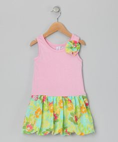 A bubble silhouette with a pretty printed skirt and fabric flower accent makes this dress a treat to meet. Its bouncy cut and stretchy cotton bodice give it a world of ease and none of the fuss.Dress: 95% cotton / 5% spandexSkirt: 100% polyesterMachine wash; dry flatMade in the USA
