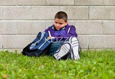 teenage boy packing his bad. - View of a teenage boy packing his bad, Model: Braden Beaudion