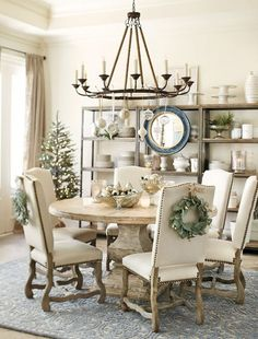 I like this look too...I like the open shelves vs. a sideboard/buffet.  Why You May Need a Round Dining Table - The Decorologist
