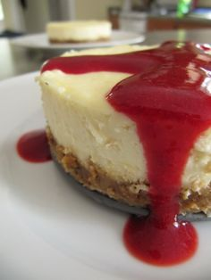 Lemon Cheesecake with Raspberry Sauce | Baked by Rachel