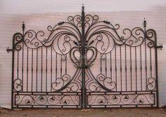 An old Gate as a Headboard. Neat Idea