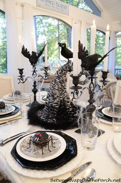 Halloween Table Setting Tablescape with Spider Cupcakes and a Witch's Hat Centerpiece