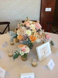 Blush centerpiece in Mercury glass. Blush garden roses, blush roses, white China mums, cream spray roses, blush spray roses, dusty miller . Flowers by Travis Payne.