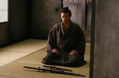 Samurai in seiza. Note the position of the blades: a subtle nuance that is missed by many students and even some dojo. The Way is much more than sword swinging, and one would do well to learn and honor all of the finer nuances and details of the art of Iaido.