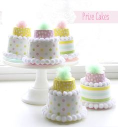 DIY candy cup prize cakes - these are adorable, like personal pinatas. Just break into it through the tissue paper bottom.