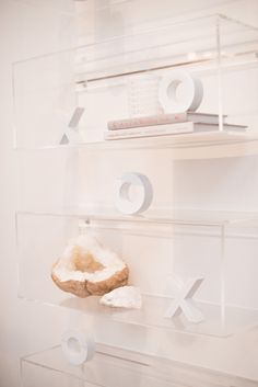 "Lucite shelves with ""XO"" decals"