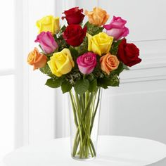 The FTD® Bright Spark™ Rose Bouquet http://www.goshenfloralinc.com/product/the-ftd-bright-spark-rose-bouquet-2012/display