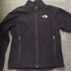 Women's Small North Face Sweater Size Small. Black North Face Sweater. Women's. 100% Polyester. Gently used, still in great conditions. Super soft and comfy fit. Has some down feather fuzzies from my winter coat, that can easily be removed with lint roller. Questions let me know. No trades! No lowball offers. The North Face Sweaters