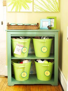 Great for kid's toys- Storage Station        What it is: A bookcase outfitted with personalized storage buckets keeps entries clutter-free.        How to make it: Prime and paint buckets to match your decor. Adjust bookcase shelves to make room for them. Secure name tags to the buckets with a metal fastener and use magnets to add to-do lists and messages.
