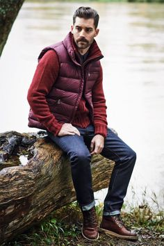 This combo of a purple quilted gilet and navy jeans will enable you to keep your off-duty style clean and simple. Smarten up your outfit with brown leather boots.  Shop this look for $177:  http://lookastic.com/men/looks/longsleeve-shirt-gilet-cardigan-jeans-boots/5809  — Black Longsleeve Shirt  — Purple Quilted Gilet  — Red Cardigan  — Navy Jeans  — Brown Leather Boots