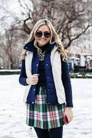 Image from http://bowsandsequins.com/wp-content/uploads/2013/12/puffer-vest-turtleneck-plaid-skirt.jpg.