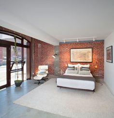 Astounding Tony Stark House Floor Plan Ideas in Bedroom Transitional design ideas with bed brick brick wall concrete concrete floor