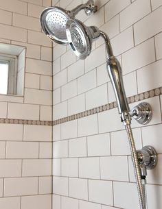 Tegels met donkere voeg Vintage looking shower head and shower wand were added to this bathroom to solidify the nostalgic look and feel. Bath To Shower Conversion, Behind Door Storage, New Toilet, Large Shower, Bathroom Hardware, Shower Heads, Wands, Really Cool Stuff, Bathroom Ideas