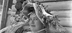 Julia in a birthday hat made of flowers was taken by her husband, Paul Child, in 1951 at his family's home in Lopaus Point, Maine.