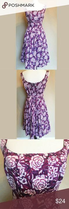 "NWT COREY P. | Floral Dress Give your summer and spring a little vintage flair in this ultra-feminine dress.  * Color: Plum/Pink * Pretty floral design throughout  * Fit and flare silhouette  * Hidden back zipper  * Attached tie-back sash * Soft pleating on skirt * Cotton/spandex blend  * Appx Length 36.5"" * Plz ask for measurements   Reasonable offers always considered. Over 175 items listed so bundle to save more! Corey P. Dresses Mini"