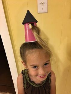 Crazy hair day - Rapunzel in her tower. Most of her hair is in a bun under the cup. The cup is bobby pinned. Stayed up all day!