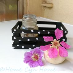 An old wooden crate + acrylic paint + 30 minutes = a cute storage box for your home.