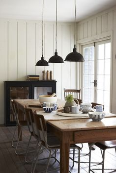 Likes - pendant lights, panelling, farmhouse table, lighter color on the walls with darker accents. MK