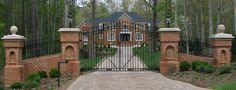 i want to have a big long driveway with a pretty gated entrance :)