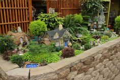 Large Fairy Garden What a nice add-on to any garden! Click for more fairy garden…