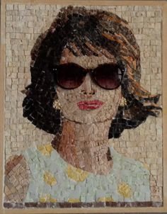The artist put real glasses onto the mosaic. J.K was such an iconic symbol.  Who is the artist?  Anyone know?