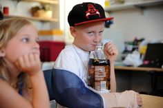 Horizon Middle School sixth grader Payton Hartley, 10, smells his classroom-made root beer July 12 during the Gifted and Talented Institute edible science class at Vista Ridge High School in Falcon School District 49. Roughly 130 students, first through 12th graders from across District 49, gathered for the district's inaugural Gifted and Talented Institute, July 8-12.