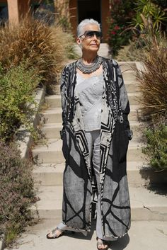 Full pants with bold patterns, tank and jacket - necklace pulls it all together