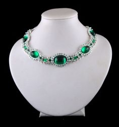 Princess Diana's emerald choker. A gift from the Queen for her wedding, Diana famously wore it as a headband across her forehead at a party.