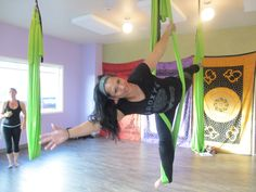 In Aerial Yoga, you are supported by a soft silk hammock as you practice your yoga poses on the ground as well as in the air!