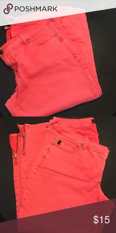 Size 18 torrid bright coral jeans One of the belt loops is broken. Zipper bottom. Size 18 cropped jeans. Fits mid calf on me and I'm 5'8. Great jeans. Worn and washed once. Jeans Ankle & Cropped