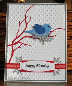 Stamps: none   Paper: white, red, 2 shades of blue scraps   Ink: none (computer generated sentiment)   Accessories: MB woodland branch die, SU bird punch, MS fern punch, Spellbinders ribbon tags, CB swiss dots ef, CB woods ef (wings), kaiser black pearl for eye, ribbon
