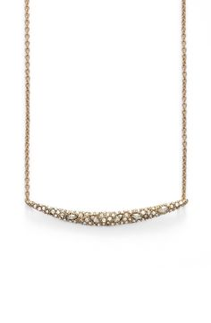 This stunning Alexis Bittar necklace may be small in scale but, it's big on sparkle with the dense scattering of Swarovski crystals.
