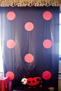 Ladybug photobooth. Use black tablecloth and red dots. Take pics of the birthday girl and guests..