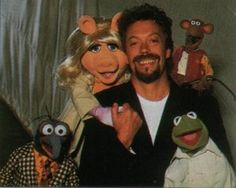 tim curry with the muppets! I don't know that you can get much more awesomeness into one picture
