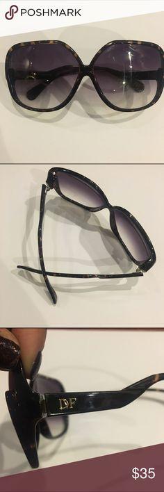 DIANE VON FURSTENBERG huge logo sunglasses Authentic Diane Von Furstenberg. Super cute. Dark plastic with gradient lenses. Dvf logo on left arm. Diane von Furstenberg Accessories Sunglasses