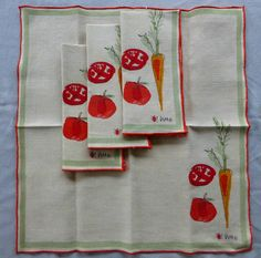 Vera carrot napkins with light green border.