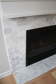 Image result for small subway tile and hex tile and fireplace