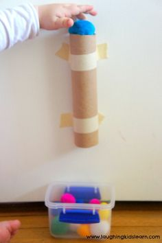 pompom drop in a paper tube
